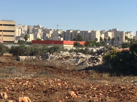 Qalandiya - where homes have been recently demolished; Jerusalem in the background.