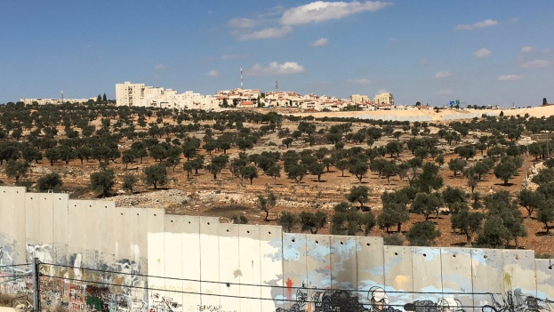 View from Aida refugee camp, Bethlehem, of fertile land the wall has captured, and a settler colony off in the distance.