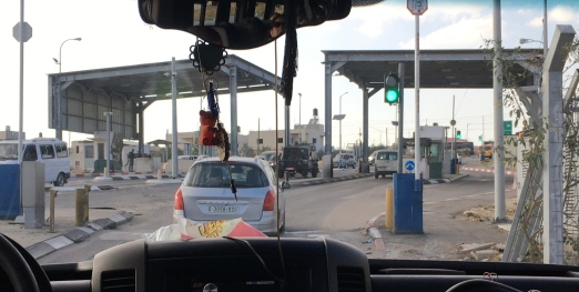 One a weekday, there is an hour-long wait to drive through this checkpoint